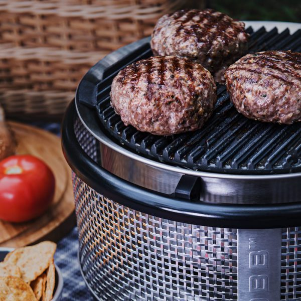 Burgers cooking on COBB grill